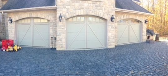 view of 3 garage doors