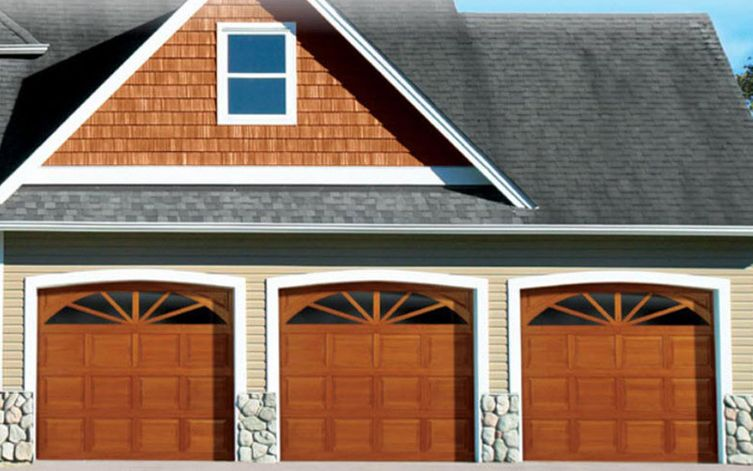 3 wooden garage doors installed in a house